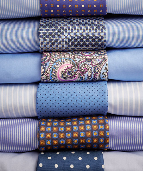 stack of business shirts with ties