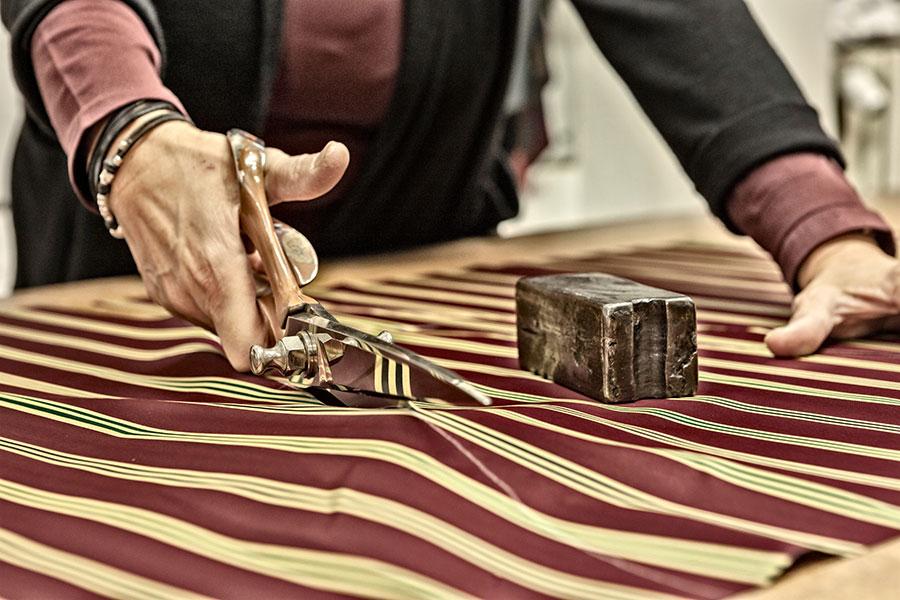 cutting the material for a maglia umbrella