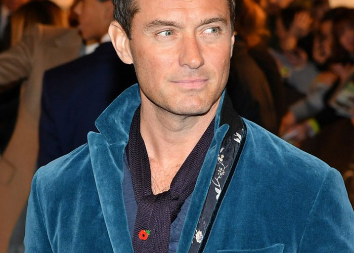 Jude Law wearing Budd silk knitted dress scarf in navy