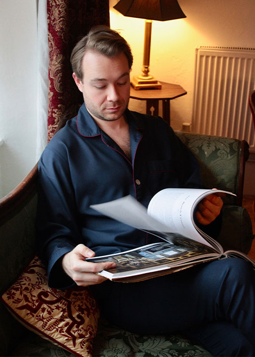 Aleks Cvetkovic in navy silk pyjamas