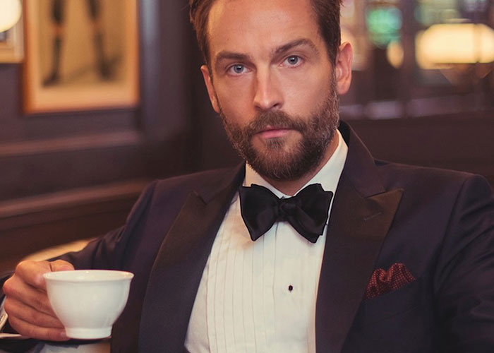 Tom Mison wearing silk dress shirt, silk bow tie and silver cufflinks and shirt studs
