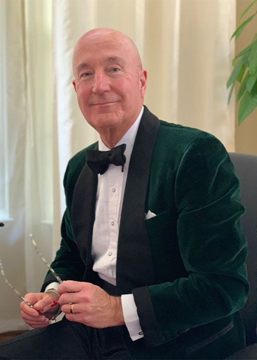 Andrew Poupart wearing Black Tie and velvet smoking jacket