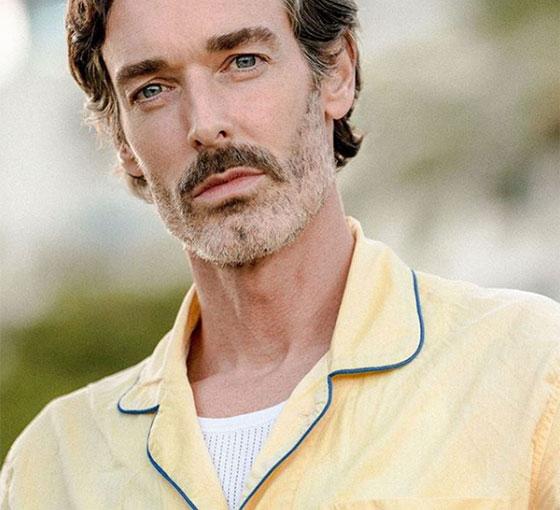 Richard Biedul wearing yellow batiste cotton pyjama shirt